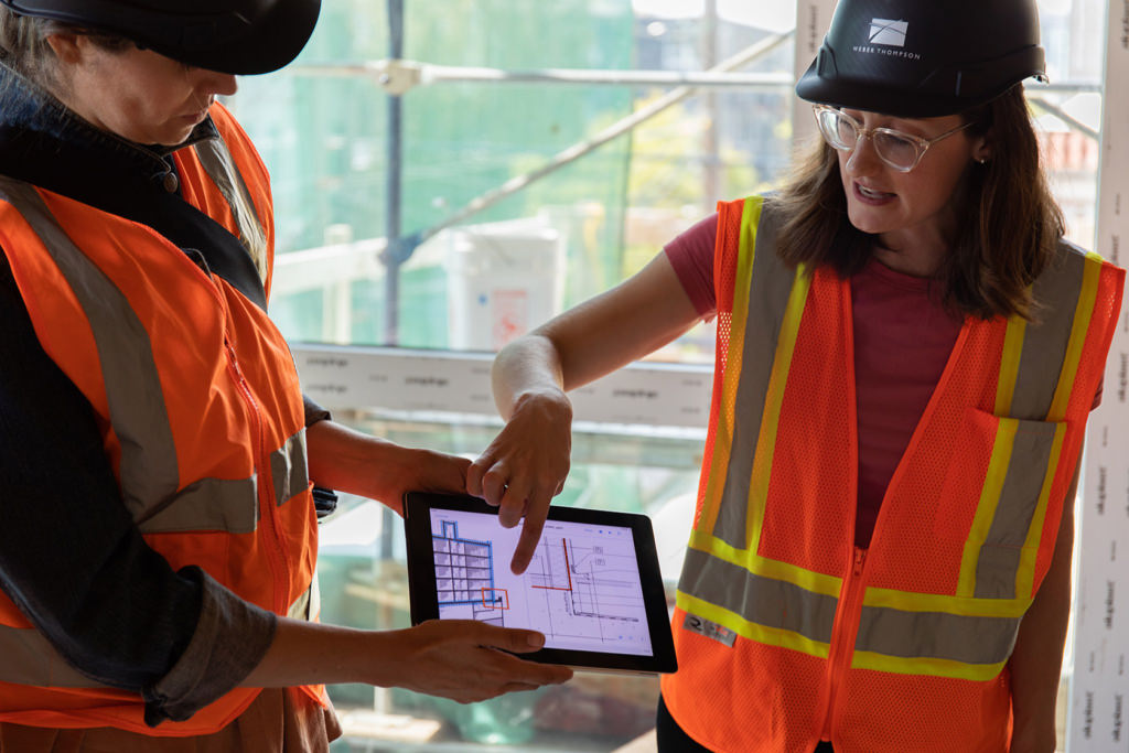 Emily Doe points at ipad screen during Solis tour